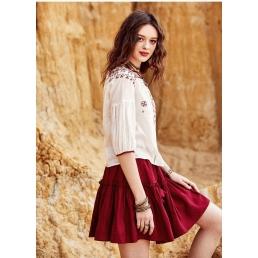Короткая однотонная юбка с оборками и завязками